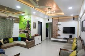 living room with studio sofa and led ceiling light in false ceiling