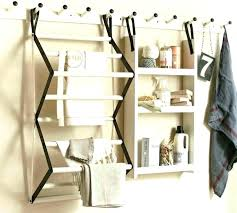 wall clothes hanging dryer rack impressive mounted clothing display throughout coat hooks nz ideas wall clothes clothing display rack
