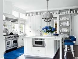 Kitchen marble top Thick Charles Edwards Light Fixture Is Suspended Above The Marbletop Kitchen Island In Lucky Brand Executives The Home Depot 17 Kitchens With Classic Marble Countertops Architectural Digest