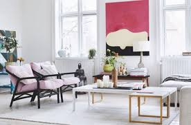 Inspiration for a scandinavian medium tone wood floor living room remodel  in Other with white walls