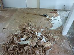 tearing out the old vinyl floor coving an old parquet floor