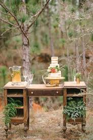 western wedding decoration vintage writing table with cake decorated with greenery rae marshall weddings