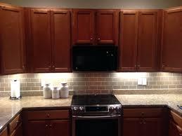 subway tile backsplash with dark cabinets champagne glass subway tile  kitchen with dark cabinets champagne glass