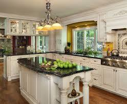 furniture white wooden kitchen cabinet and three track pendant lamp over black granite kitchen islands