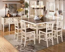 whitesburg 9 piece square counter height extension table set in brown white