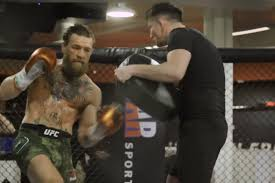 Conor McGregor looks sharp and dangerous as he does a hard ...