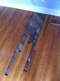 cost to replace damaged hardwood floor