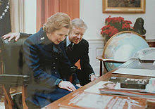 the oval office desk. british prime minister margaret thatcher reads the inscription on front of desk in 1979 accompanied by president jimmy carter oval office d