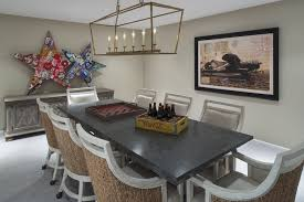 linear dining room lighting. Ozark Shadows Framing Vintage Plane Art Behind A Gray Dining Table Lined With Seagrass Backed Chairs On Castors Illuminated By An Darlana 6 Light Linear Room Lighting I