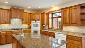 how to clean sticky wood kitchen cabinets the most joe truini using hot sponge to clean