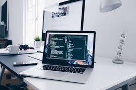 office hd wallpapers. HD Wallpaper Code On A MacBook Laptop In Minimal Office Office Hd Wallpapers