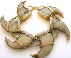 an antique gold and tiger claw bracelet the 15 18k yellow gold engraved mounts