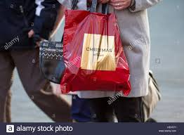 marks spencers pers with gift bags of purchases in liverpool one two merseyside uk