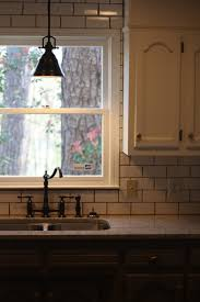 over the sink lighting. kitchen lighting over sink elliptical steel mid century modern glass green countertops islands flooring backsplash pretty the n