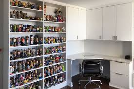 Office space memorabilia Stock Personalized Office With Memorabilia Storage Ideas Fantasies Come True Home Office With Corner Desk Bookcase Shelves And Bobblehead Display
