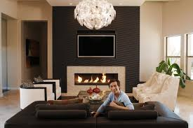 ki ngo has a streamlined fireplace that complements the tv at his gilbert ariz
