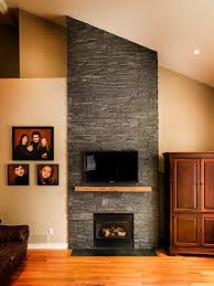 dark stone veneer fireplace with wood mantel traditional family room