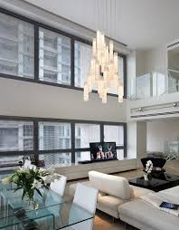 white candles chandelier by galilee lighting two story living room chandelie contemporary living