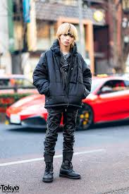 all black 99 is street style w blond hair studded leather jacket leather pants puffer jacket vintage boots