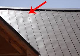residential roofing project using sheffield metals oil canning example