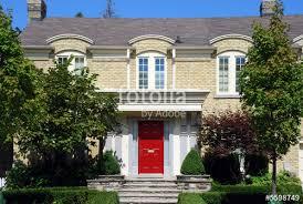 yellow brick house red door. yellow brick house with red door i