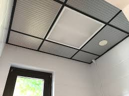 gone are the boring white tiles and now we have a completely new space from floor to ceiling it was easy and inexpensive thank you decorative ceiling