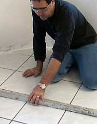 install hardwood floor over tile