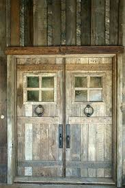 barn front doorMy husband keeps asking what type of doors I want on the new hay
