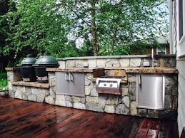outdoor kitchen with double big green eggs and fire magic appliances