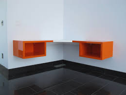 l shaped floating table or corner floating table with under open storage in orange and white