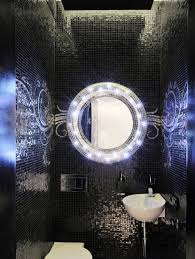 vanity with lights around mirror. modern led lights around bathroom vanity mirror on black tile wall: full size with