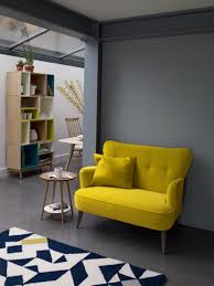 Everybody needs a nice little yellow sofa. Room changers: the key pieces  that can transform any room.