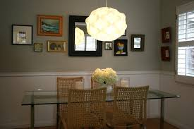 remodeling dining room design with mirror glass table glass dining table chair rail casual dining room lighting