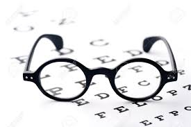 Lying Eye Chart Old Fashioned Round Black Eyeglasses Lying Over The Eye Checking