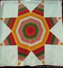 Vintage and vintage-inspired quilts | Quilt Inspiration | Bloglovin' & We spotted this Star of Bethlehem quilt, done in calicoes and solids,  hanging at the end of an aisle at the 2014 Tucson Quilters' Guild show. Adamdwight.com