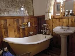 Rustic bathroom design Outdoor Rustic Bathroom Design The Spruce 12 Rustic Bathrooms Youll Adore
