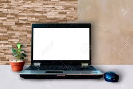 decorate office. Picture Of Laptop, Mouse, Decorate Plants On Office Table, Brick-wall,