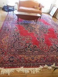 large vintage iranian red mashad wool rug