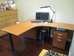 charming office area feats l shaped office desk with black metal legs also  small cabinet