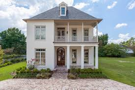 Inspiration for a mid-sized timeless white two-story brick exterior home  remodel in