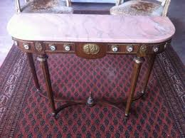 a beautiful marble top side or console