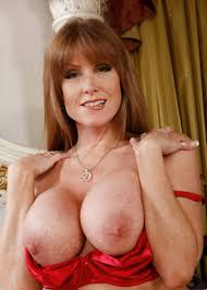 Big hooters redhead mature