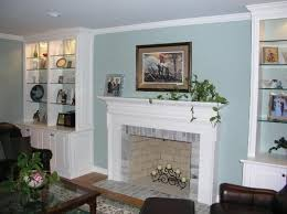 custom made built in fireplace cabinetry and mantle
