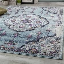 novelle home sovereign pink blue flower bud border area rug
