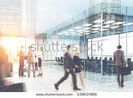 suits office. Beautiful Office View Of Men And Women In Suits Walking A Glass Office City View Is To Suits Office