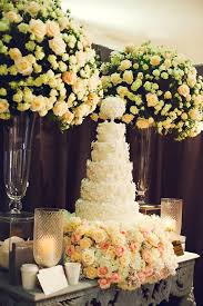 flowers on wedding cake. bed of flowers. for the bride that is aiming a glamorous and romantic look flowers perfect option. on wedding cake