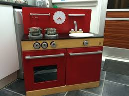 John Lewis Kitchen Appliances John Lewis Red Wooden Play Kitchen With Ikea Pots And Pans Set