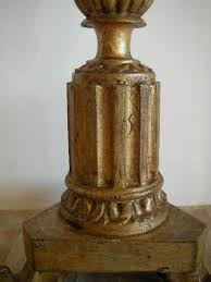 large gilt wooden church candle holder with carved acanthus leaves 19th century france
