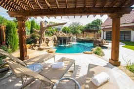 backyards design. Stylish Wooden Pergola With Comfortable Lazy Chairs Using Traditional Swimming Pool Design For Small Backyards Rock Decor