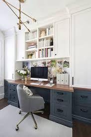 home office built ins. pretty sure this is my dream office. love the dark blue gray lower desk cabinets, wood top and white uppers. beautiful home office idea. built ins